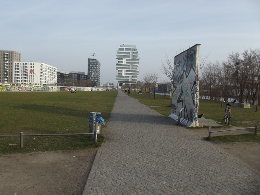 Park next to the Berlin Wall. The shoprt section of wall on the right shows a cross-section of it.