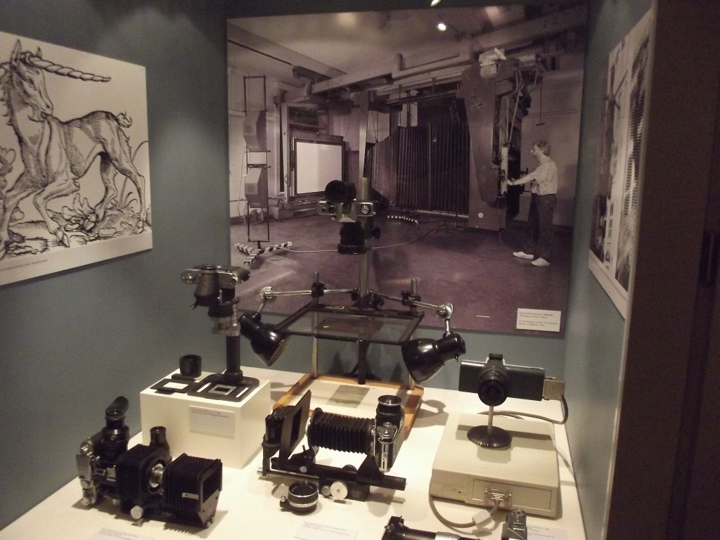 Photographic equipment, note the photo in the background of a large process camera.