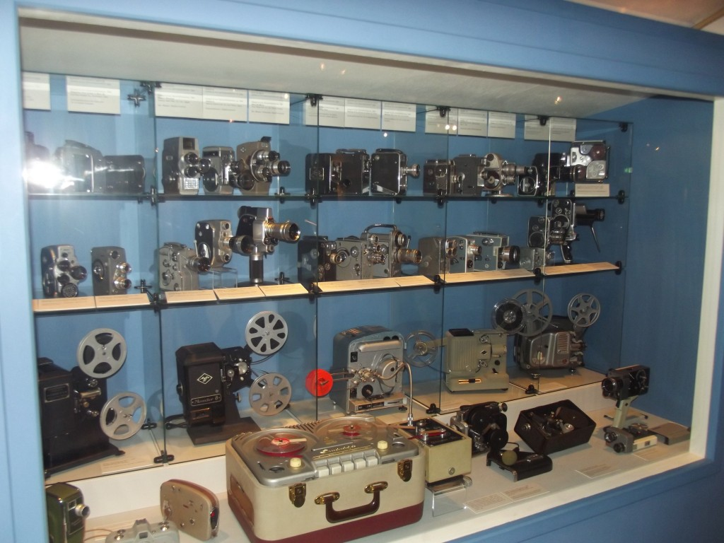 A seelction of cine cameras and projectors, mostly 8 mm. There is also a large tape deck; the only way to have sound in home movies before the advent of the Super 8 format was to use one of these machines. There were even various gadgets to synchronise film and sound.
