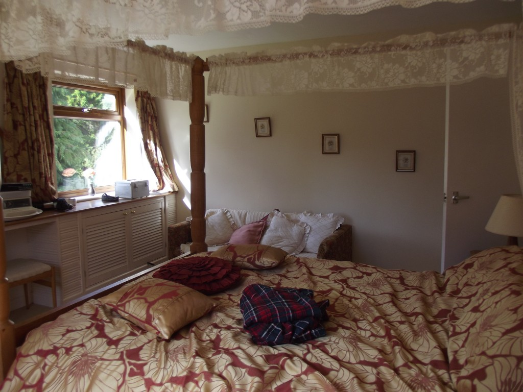 My bedroom - with the luxury of a four-poster bed!